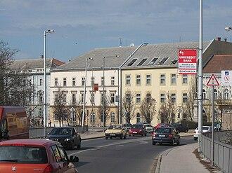 Varga Katalin Secondary School - The school, at left, as seen from the Tisza bridge