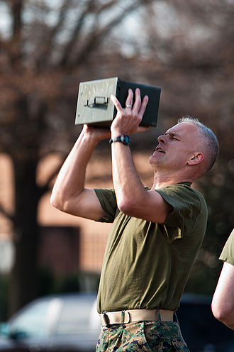 Combat Fitness Test - Major General Vaughn Ary, Staff Judge Advocate to the Commandant displays lifting 30 lb ammo can 100 times during combat fitness test on December 4, 2011