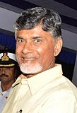 Vice Admiral Satish Soni presenting a memento to Andhra Pradesh CM Chandrababu Naidu, the Chief Guest on Navy Day 2014 cropped.jpg
