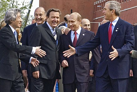 Russian President Vladimir Putin with George W. Bush and other Western leaders in Moscow, 9 May 2005 Victory Day Parade 2005-26.jpg