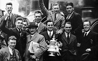 1931 FA Cup Final - The Albion team display the FA Cup at Paddington Station after their victory in the final.