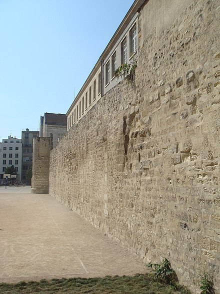 Remains of the Wall of Philip II Augustus built around Paris before he went to the Crusades. The segment pictured here is found in the Rue des Jardins-Saint-Paul, Paris. Wall of Philippe Auguste in Paris.jpg