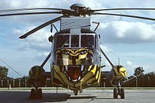 A Westland Sea King HAS6 of 814 NAS in a tiger colour-scheme, representing the unit's status as a member of the NATO Tiger Association.