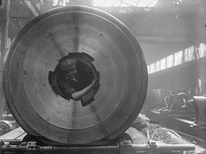 Welin breech block - Image: Woman Cleaning 15inch Gun Rifling COW