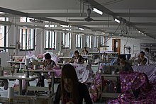 Women working at sewing machines in a large room