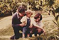 Young boy, mother and grandfather in a garden - 1984-05.jpg