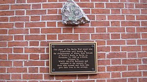 """Zion Lutheran Church (Baltimore, Maryland) - A piece of the Berlin Wall at Zion Church, Baltimore, MD. The inscription reads: """"This piece of the Berlin Wall stood near Lichterfelde until broken by the sledgehammer of Mr. Rick DeLisle on November 11, 1989, at 6:50 am. Donated by WMIX 106.5 FM Baltimore and dedicated to those who crossed and those who gave their lives in the attempt."""