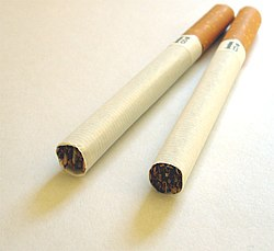 Unlit filtered cigarettes.