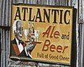 """ATLANTIC ALE and BEER"" ""Full of Good Cheer"" sign, from- African American migratory workers by a 'juke joint'. Belle Glade, Florida, February 1941 (cropped).jpg"