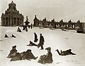 """After the Fair was Over."" (People sledding down Art Hill after the closing of the 1904 World's Fair. East Restaurant Pavilion and Colonnade of States in background).jpg"