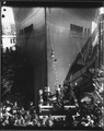 """USS CALIFORNIA (BB44) Launching Ceremony, Mrs Barbara Zane , ship's sponsor, crashing the chritening bottle on the... - NARA - 296906.tif"