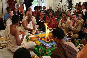 Brahmin - Brahmins in white dress performing the Bhumi Puja ritual yajna around fire