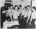 (Recruits receiving inoculations at the dispensary, U.S. Naval Training Station, San Diego, California.) - NARA - 295565.tif