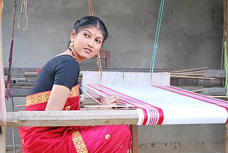 Gamosa - A woman seen traditionally weaving a Gamosa