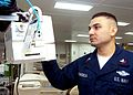 081125-D-9999F-001 - HM2 Luis Fonseca checks piece of medical equipment.jpg