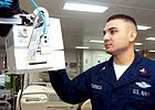 081125-D-9999F-001 - HM2 Luis Fonseca checks piece of medical equipment