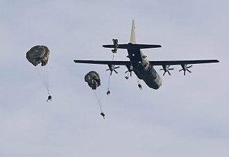 16 Air Assault Brigade - Paratroopers from 16 Air Assault Brigade jump from a Royal Air Force C-130 Hercules over Salisbury Plain during Exercise Wessex Storm on 19 November 2014.