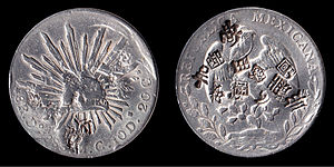 Chop marks on coins - 1888 Mexican 8 reales silver coin having multiple chop marks made by Chinese merchants