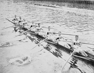 Rowing at the 1912 Summer Olympics – Men's eight - Sport Borussia with the winning Berlin in the background.