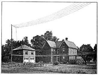 "Frank Conrad - Conrad's home in Pittsburgh showing the ""flat-top"" antenna with counterpoise used for his experimental radio station 8XK."
