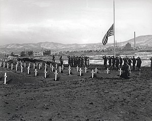 Hamhung - Marines of the 1st Marine Division pay their respects to fallen marines during memorial services at the division's cemetery at Hamhung, Korea, following the break-out from Chosin Reservoir, 13 December 1950
