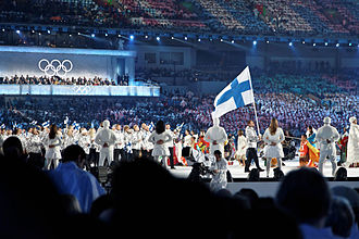 2010 Winter Olympics national flag bearers - The Finnish flag being carried by Ville Peltonen.