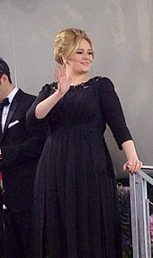 Adele in a black dress.