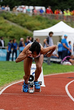 This sprinter's initial crouch in the blocks allowed her to preload her muscles and channel the force generated from this into her first strides. 2014 DecaNation - 400 m 20.jpg