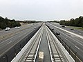 2018-10-26 10 51 58 View west along Virginia State Route 267 (Dulles Toll and Access Roads) and the Silver Line of the Washington Metro from the overpass for Virginia State Route 286 (Fairfax County Parkway) in Reston, Fairfax County, Virginia.jpg