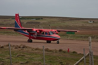 Transport in the Falkland Islands - A Britten-Norman Islander owned by FIGAS touching down at a landing strip on Sea Lion Island