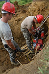 820th REDHORSE electricians install new light poles 140722-F-YC840-026.jpg