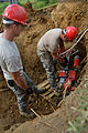820th REDHORSE electricians install new light poles 140722-F-YC840-026.jpg