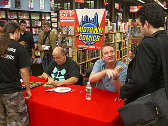 The Dark Tower: Treachery - Writer Peter David and artist Mike Perkins, at the midnight signing of Treachery and The Stand: Captain Trips at Midtown Comics in Times Square, Manhattan, September 10, 2008. At far right is Alan Kistler of ComicMix, interviewing Perkins.