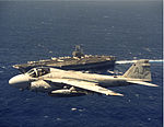 A-6E VA-35 flies over USS Theodore Roosevelt (CVN-71) c1989.jpeg
