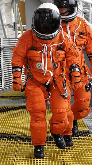 Advanced Crew Escape Suit - An astronaut wearing the ACES suit
