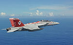 A U.S. Navy F-A-18F Super Hornet aircraft assigned to Strike Fighter Squadron (VFA) 102 flies near the aircraft carrier USS George Washington (CVN 73), not pictured, in the Philippine Sea Aug. 21, 2013 130821-N-ZZ999-0023.jpg