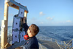A U.S. Sailor assigned to the guided missile cruiser USS Antietam (CG 54) score targets after a small-arms training exercise Aug. 7, 2013, while underway in the Coral Sea 130807-N-TG831-024.jpg