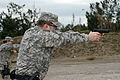 A U.S. Soldier with the 464th Military Police Platoon fires an M9 Beretta pistol during training at Camp Darby in Livorno, Italy, March 12, 2013 130312-A-II094-009.jpg