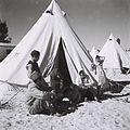 A YEMENITE FAMILY IN FRONT OF THEIR TENT IN THE EZRA UBITZARON QUARTER IN RISHON LEZION. עולים מתיתן גרים באוהלים בשכונה חדשה בראשון לציון.D835-104.jpg
