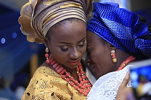 Yoruba culture -  A Yoruba bride hugs her mother on her traditional wedding day. This is a farewell hug from mother to daughter. Nigerian Yoruba wedding