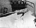 A dead man, wearing robes, lying on his deathbed. Photograph Wellcome L0026322.jpg