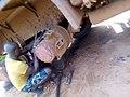 A mechanic man repairing a truck.jpg