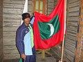 Adl Mohamed with Maldivean flag.jpg