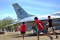 Adults search for eggs at an Easter egg hunt March 30, 2013, at Unity Park at Cannon Air Force Base, N.M. More than 400 children participated in the hunt, gathering more than 3,000 hidden eggs 130330-F-KB862-117.jpg