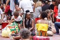 African Street Style Festival 2016 - Two women chatting while children play fight in the background.png