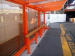 Airport bus leaning bench (25322276915).jpg