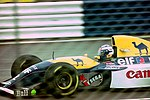 Alain Prost - Williams FW15C heads for Copse during practice for the 1992 British Grand Prix (33557462981).jpg