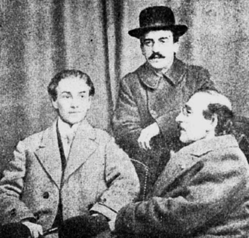 Alexandru Macedonski (seated, to the right) facing Oreste Georgescu. Alexis Macedonski standing Alexandru Macedonski, Alexis & Oreste Georgescu.JPG