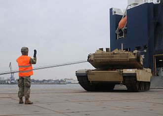 Operation Atlantic Resolve - A US Army tank driving off a ship at Riga, Latvia, during a training exercise conducted as part of Operation Atlantic Resolve in March 2015