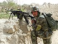 An Afghan National Army soldier with the 1st Brigade, 205th Corps provides security near the village of Sperwan, Kandahar province, Afghanistan, April 1, 2012 120401-A-OR326-001.jpg